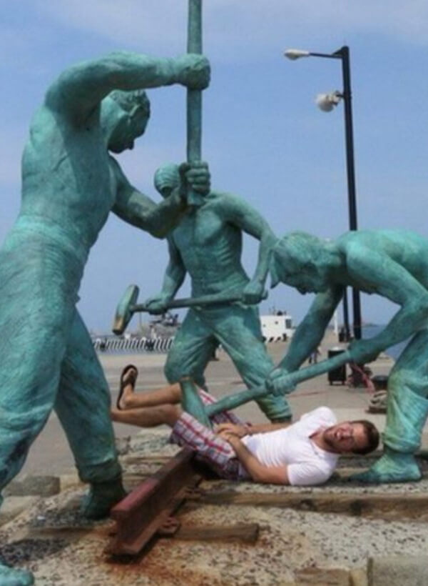 people having fun with statues 1