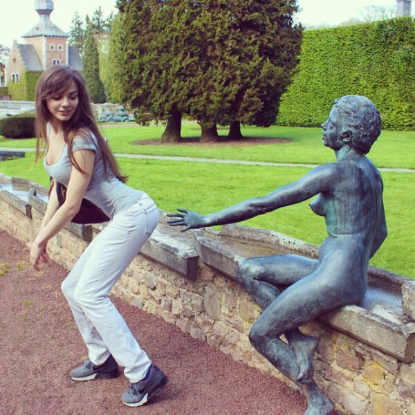 people having fun with statues 2