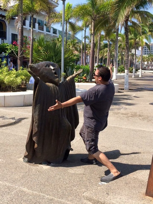people having fun with statues 8